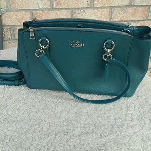 Teal coach purse with wallet- never used, no tags